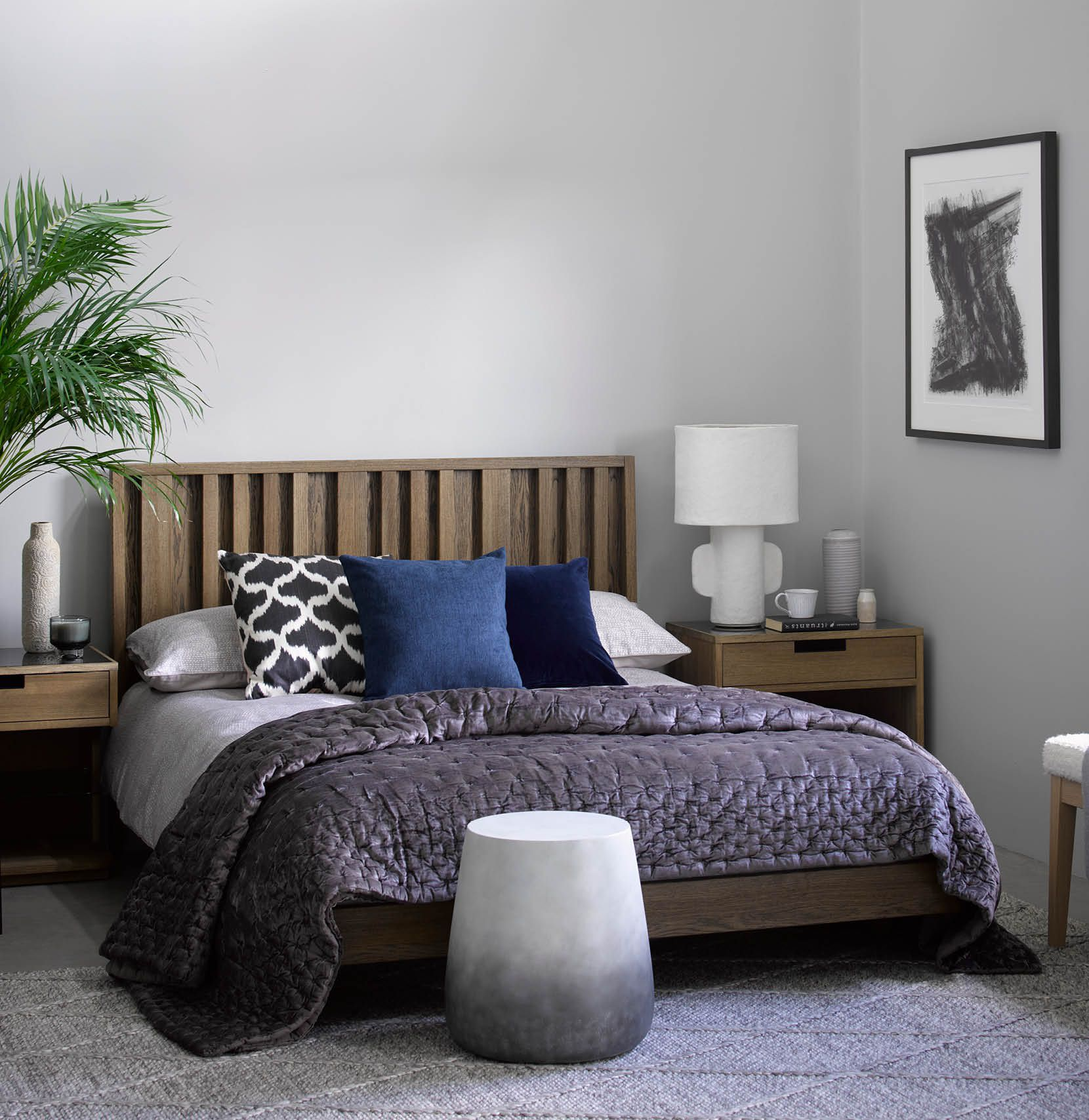 Ravello wooden bed featured in a comptepray tranquil bedroom also featuring Turin bedside tables, Lombard Coffee table and Beamont rug