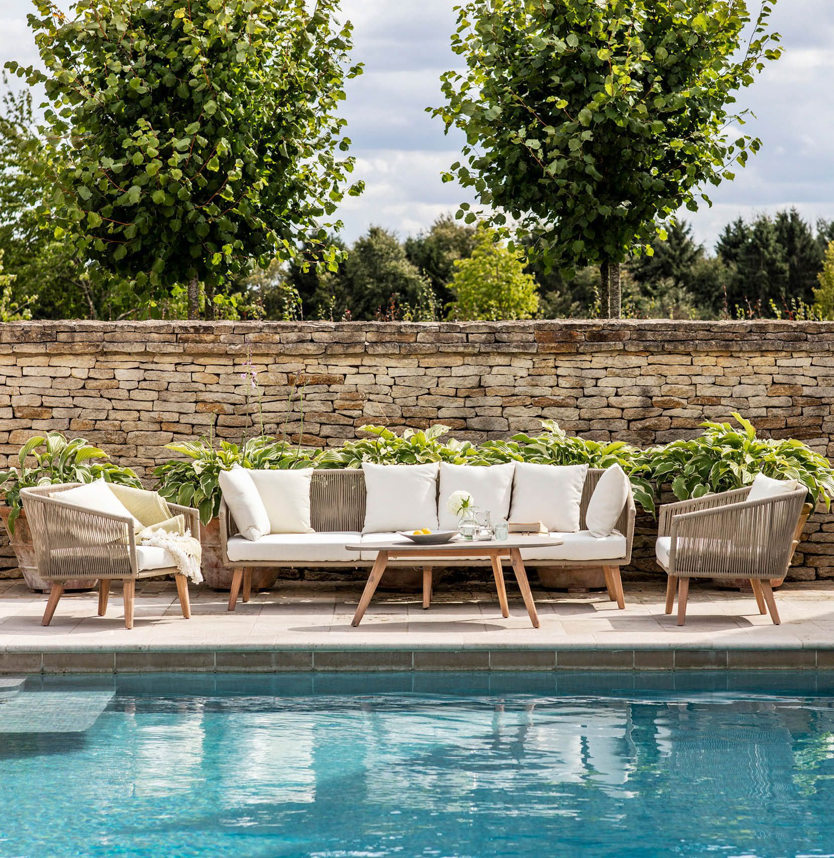 Colwell sofa set with armchair table in garden next to swimming pool