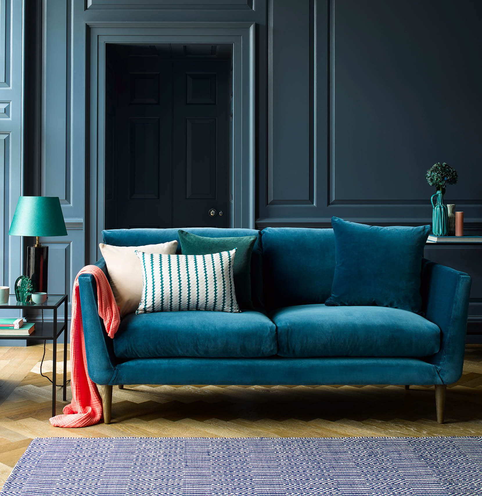 Holly velvet sofa in Deep Turquoise styled in contemporary living room