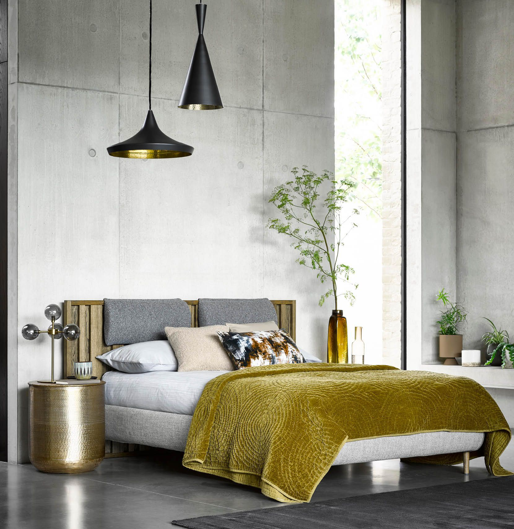 Add a bit of lair - Stunning contemporary bedroom furnished with Tom Dixon lighting beat pendents, Verona headboard cushions attached to Florence fabric and wooden bed.