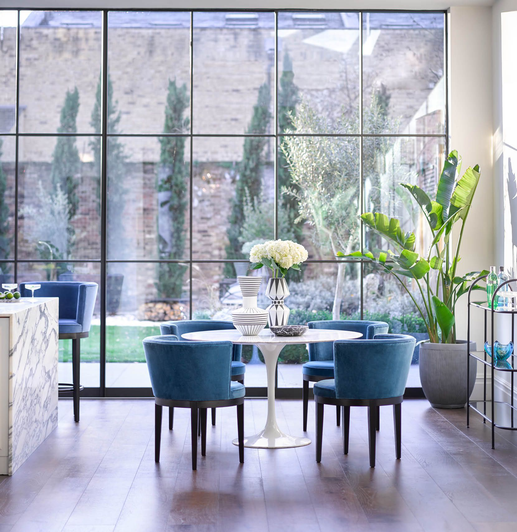 Dining room table and Margaux dining chairs in open-plan kitchen