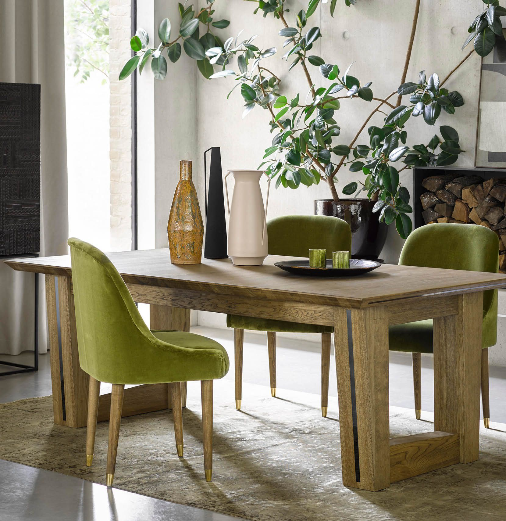 Aspen oak dining table and Arabella dining chairs in olive green velvet fabric furnished in a cosy rustic contemporary living interior